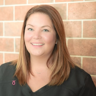 Patrica is shown here smiling as part of our Orthodontist in Souderton's team