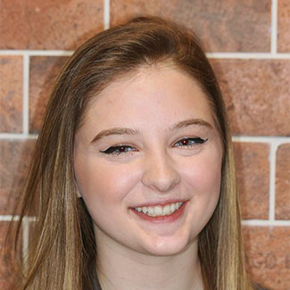 Jenna smiling because she is part of our Orthodontist in Souderton's team
