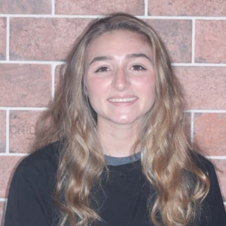 Jules smiling because she is part of our Orthodontist in Souderton's team